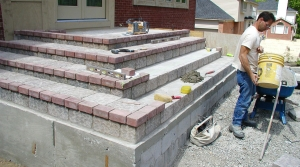 Hardscaping Clarkston MI - Brick Pavers | Landscape Gardens - guy_working